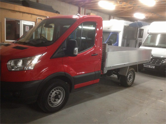 AV Bodies Commercial Vehicle Bodybuilders Red Dropside Van Front View
