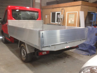 AV Bodies Commercial Vehicle Bodybuilders  Red Dropside Vehicle Rear View