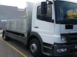 AV Bodies Commercial Vehicle Bodybuilders  White Dropside Van