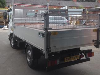 AV Bodies Commercial Vehicle Bodybuilders  White Dropside Van rear view