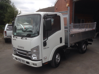 AV Bodies Commercial Vehicle Bodybuilders White Dropside Van Front View